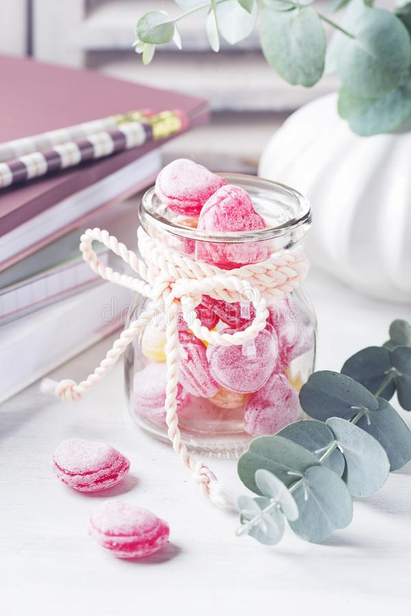 Sweets in a glass jar. On a table royalty free stock photo