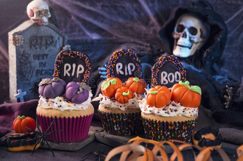 Sweets for halloween party. On a wooden background stock image