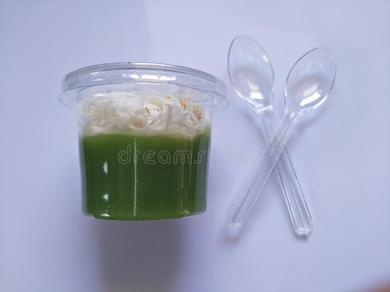 Sweets, pandan flavor in glass with a spoon for eating white background stock photography