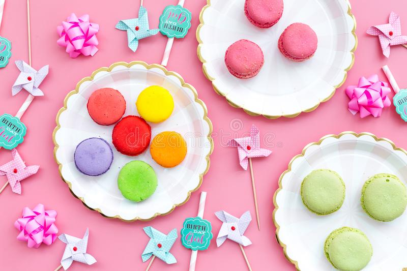 Sweets for party background. Macarons and lollipop on pink top view copy space royalty free stock photo