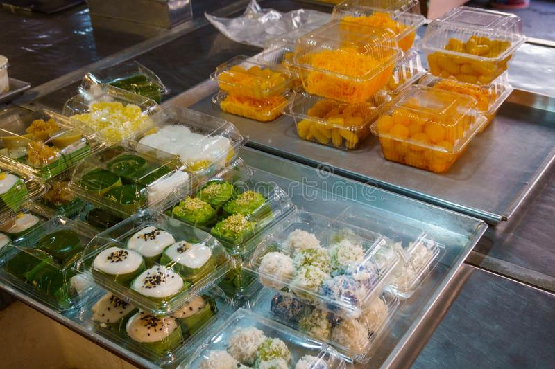 Thai style desserts in plastic boxes in the street market royalty free stock photography