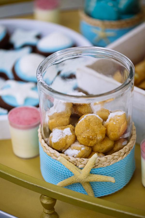 Sweets in a starfish jar on marine thematic candy bar. Wedding buffet royalty free stock photos