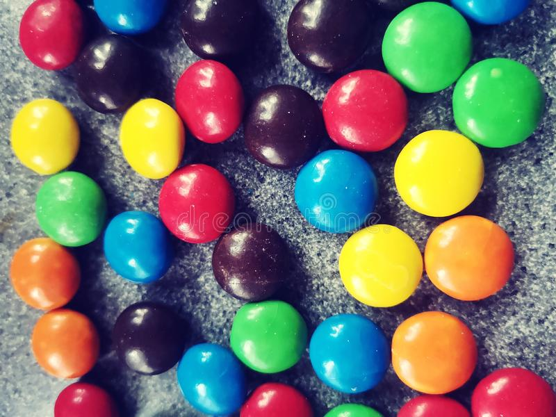Sweets , colorful candies on the table royalty free stock photography