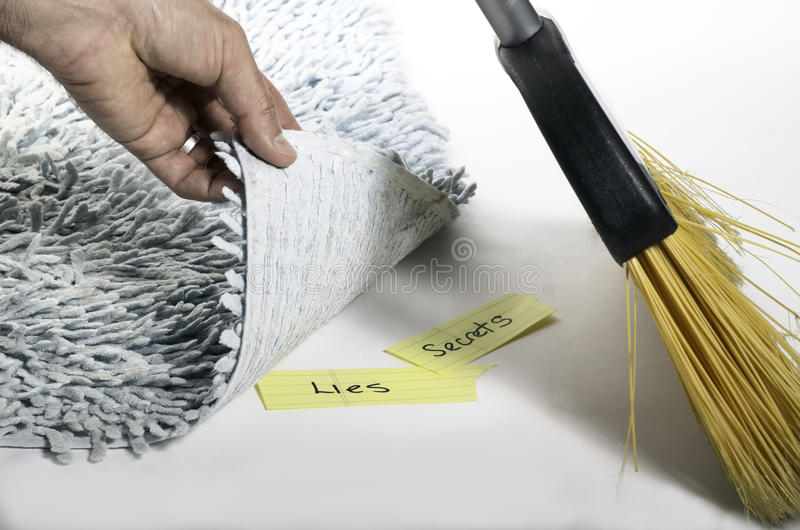 Swept under the rug royalty free stock images