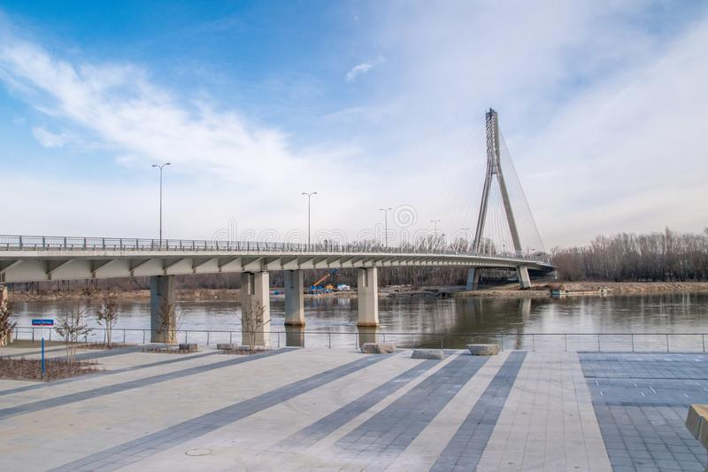 Swietokrzyski bridge over the Vistula river in Warsaw, Poland.  stock photo