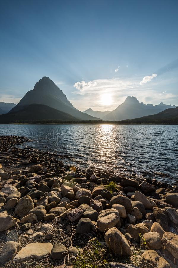 Swiftcurrent Lake in Many Glacier area of Montana Glacier National Park in the late afternoon stock images
