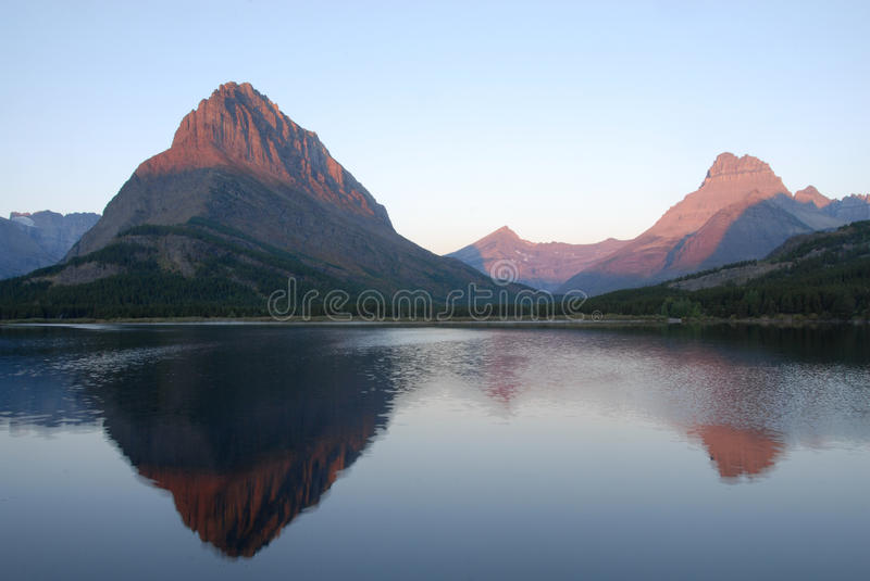 Swiftcurrent Lake and Mountains royalty free stock photos
