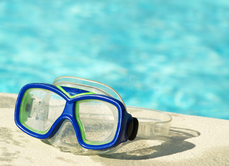 Swim mask by the pool royalty free stock image