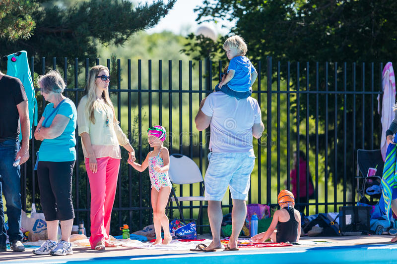 Swim meet. Denver, Colorado, USA-July 11, 2015. Kids swim meet in outdoor pool during the summer stock images