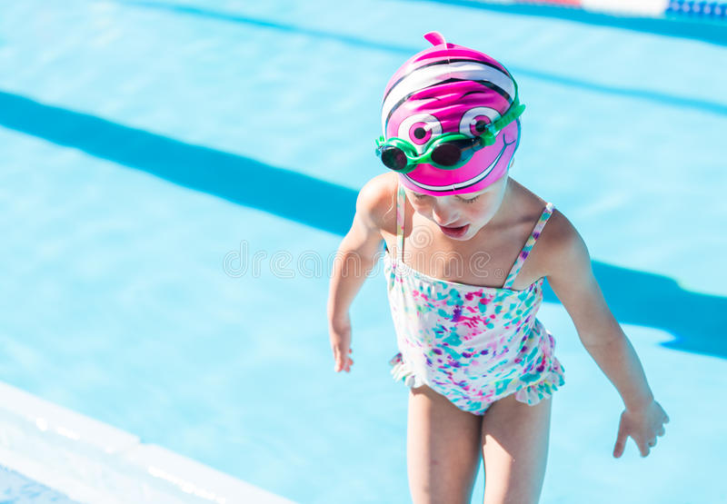 Swim meet. Denver, Colorado, USA-July 11, 2015. Kids swim meet in outdoor pool during the summer stock photos
