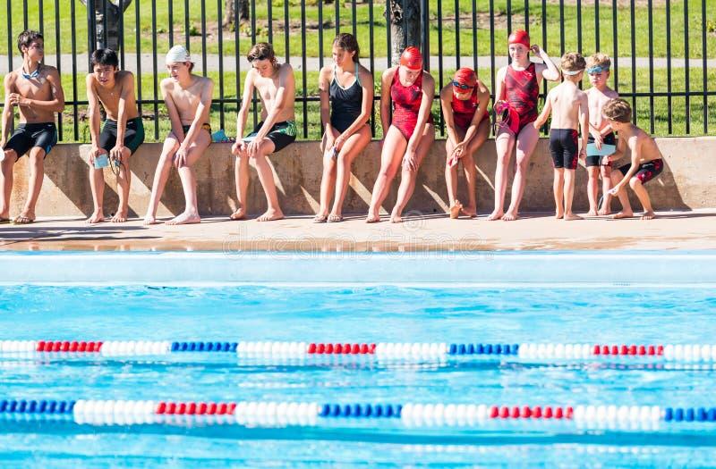 Swim meet. Denver, Colorado, USA-July 11, 2015. Kids swim meet in outdoor pool during the summer royalty free stock photos