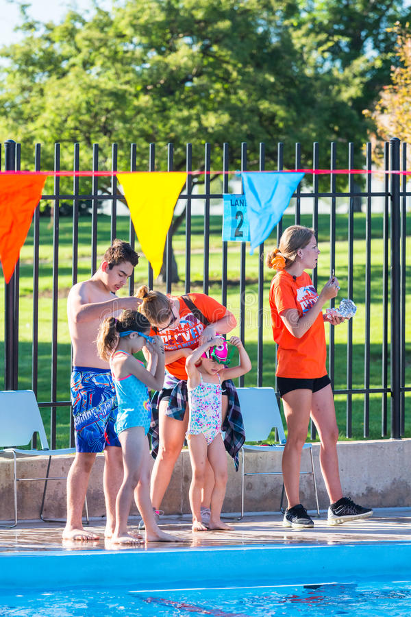 Swim meet. Denver, Colorado, USA-July 11, 2015. Kids swim meet in outdoor pool during the summer royalty free stock photography
