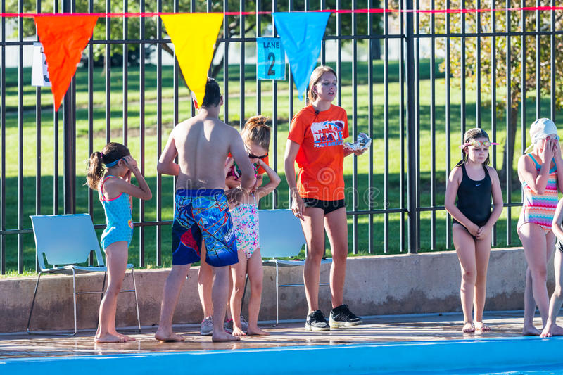 Swim meet. Denver, Colorado, USA-July 11, 2015. Kids swim meet in outdoor pool during the summer royalty free stock images