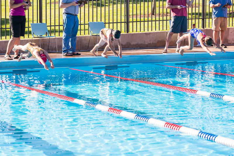 Swim meet. Denver, Colorado, USA-July 11, 2015. Kids swim meet in outdoor pool during the summer stock photography