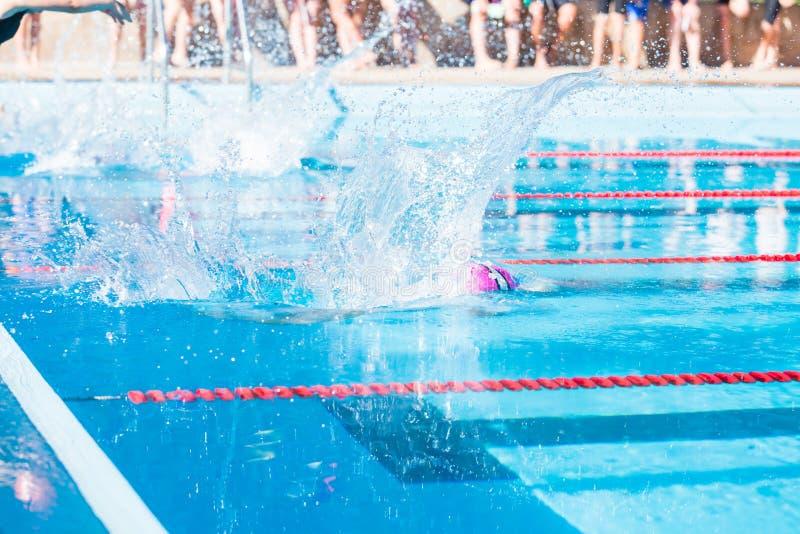 Swim meet. Denver, Colorado, USA-July 11, 2015. Kids swim meet in outdoor pool during the summer royalty free stock photo