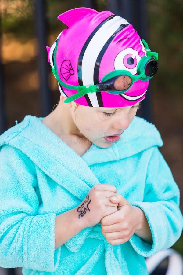 Swim meet. Denver, Colorado, USA-July 11, 2015. Kids swim meet in outdoor pool during the summer royalty free stock image