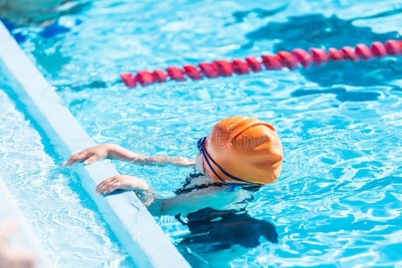 Swim meet. Denver, Colorado, USA-July 11, 2015. Kids swim meet in outdoor pool during the summer stock image