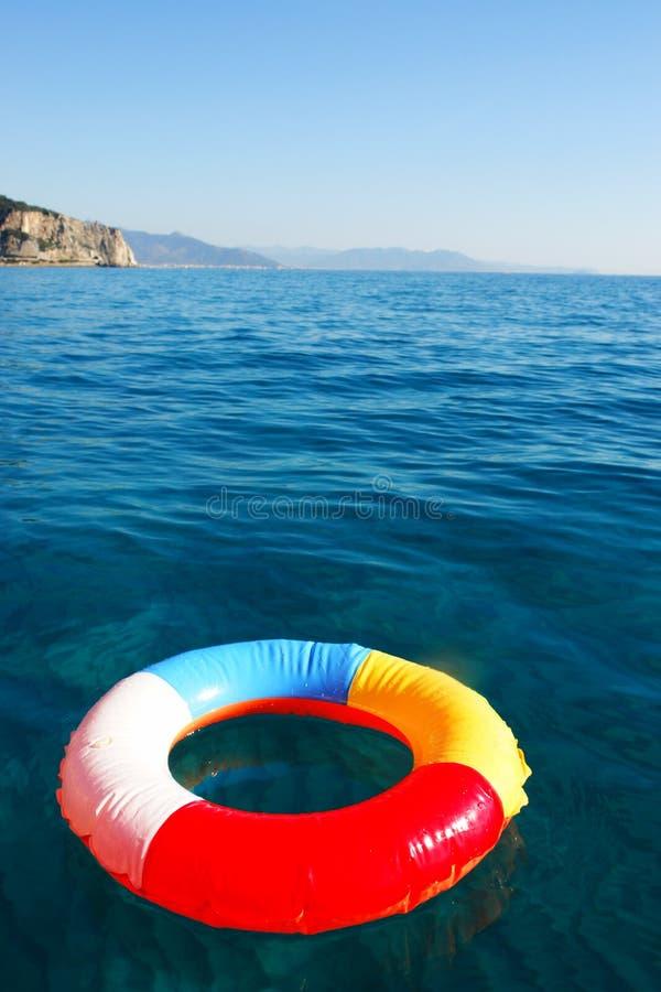 Swim Ring. Floating on beautiful blue water royalty free stock photo