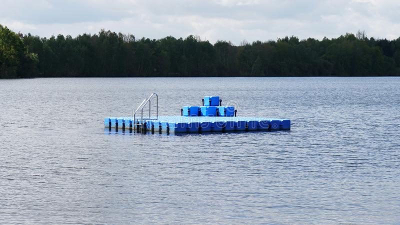 Swim or swimming platform on bathing lake. Swim or swimming platform floating on bathing lake royalty free stock images