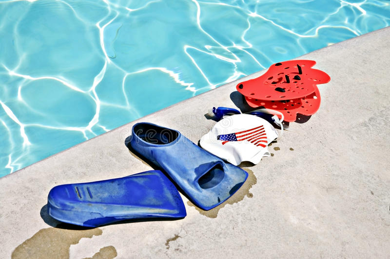 Swim Training Equipment. Swimmers training equipment on the side of a pool stock photography