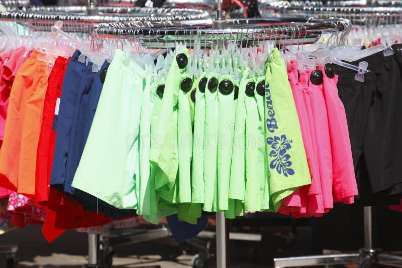Swim Trunks. On a clothes rail royalty free stock photos