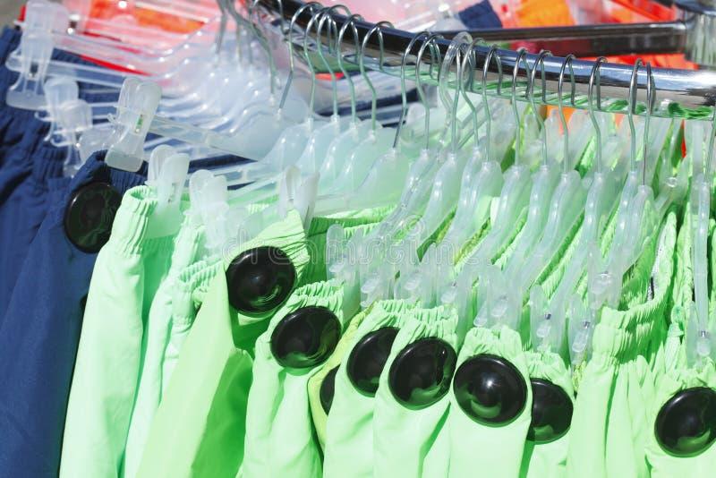 Swim Trunks. On a clothes rail stock photos