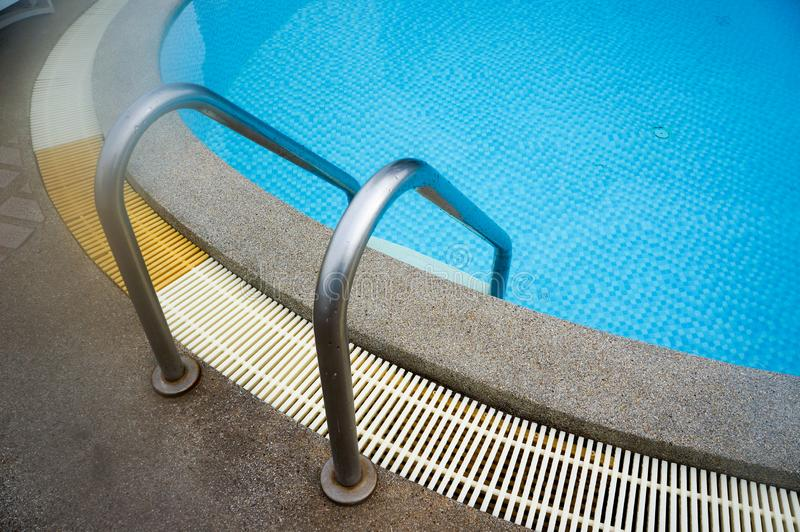 Swimming pool stair reach down into the water stock image