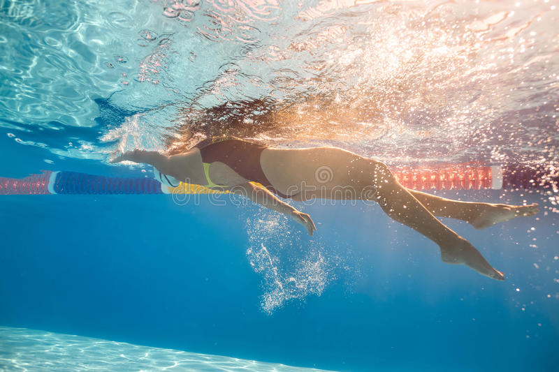 Swimmer in back crawl style underwater royalty free stock image