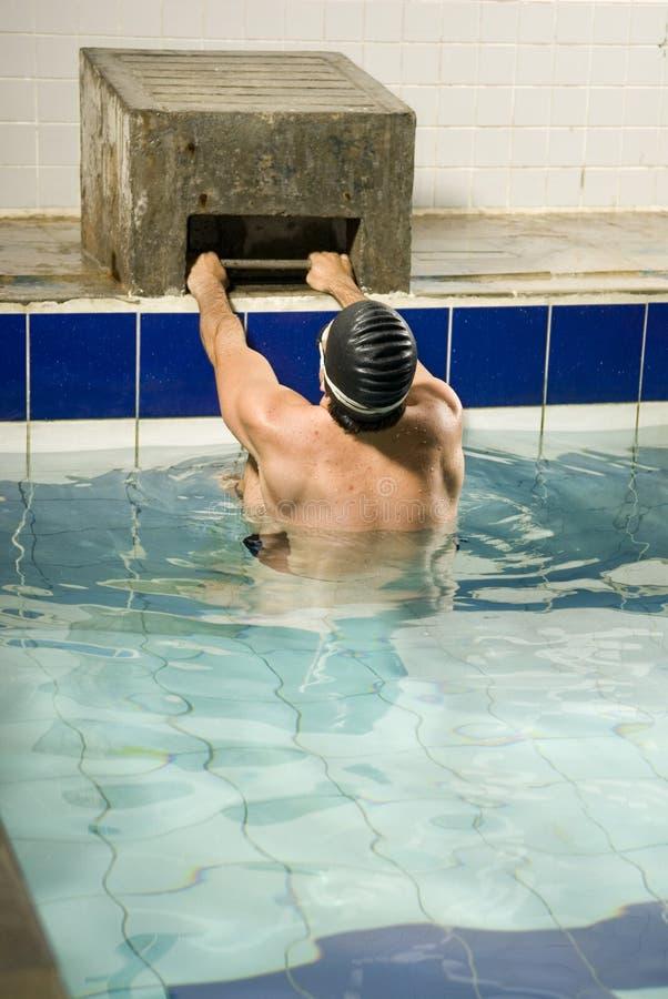 Swimmer Holding onto Block stock images