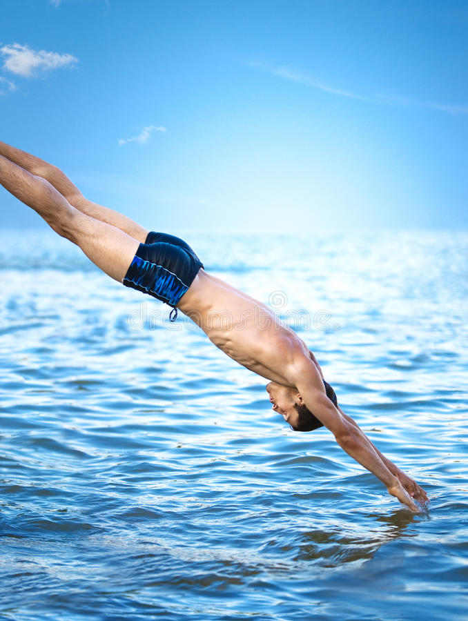 Swimmer jumping. To sea water stock photo
