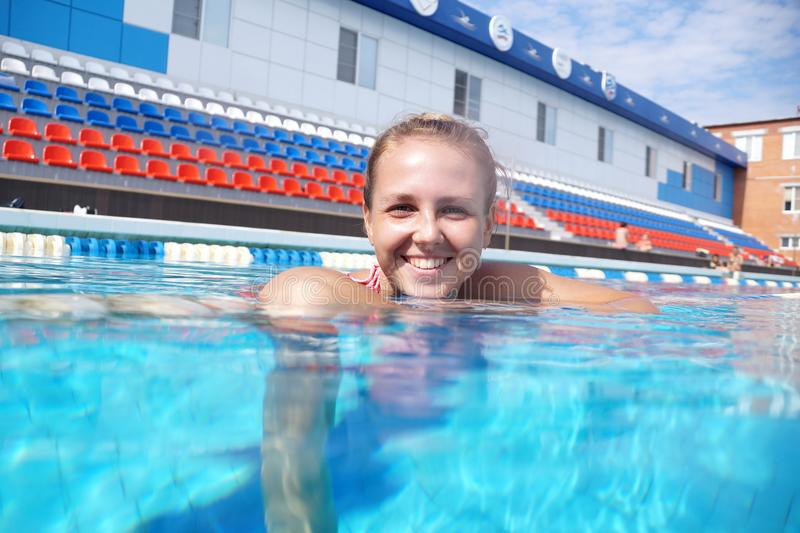 Swimmer in the swimming pool. Swimmer in the big outdoor swimming pool stock image