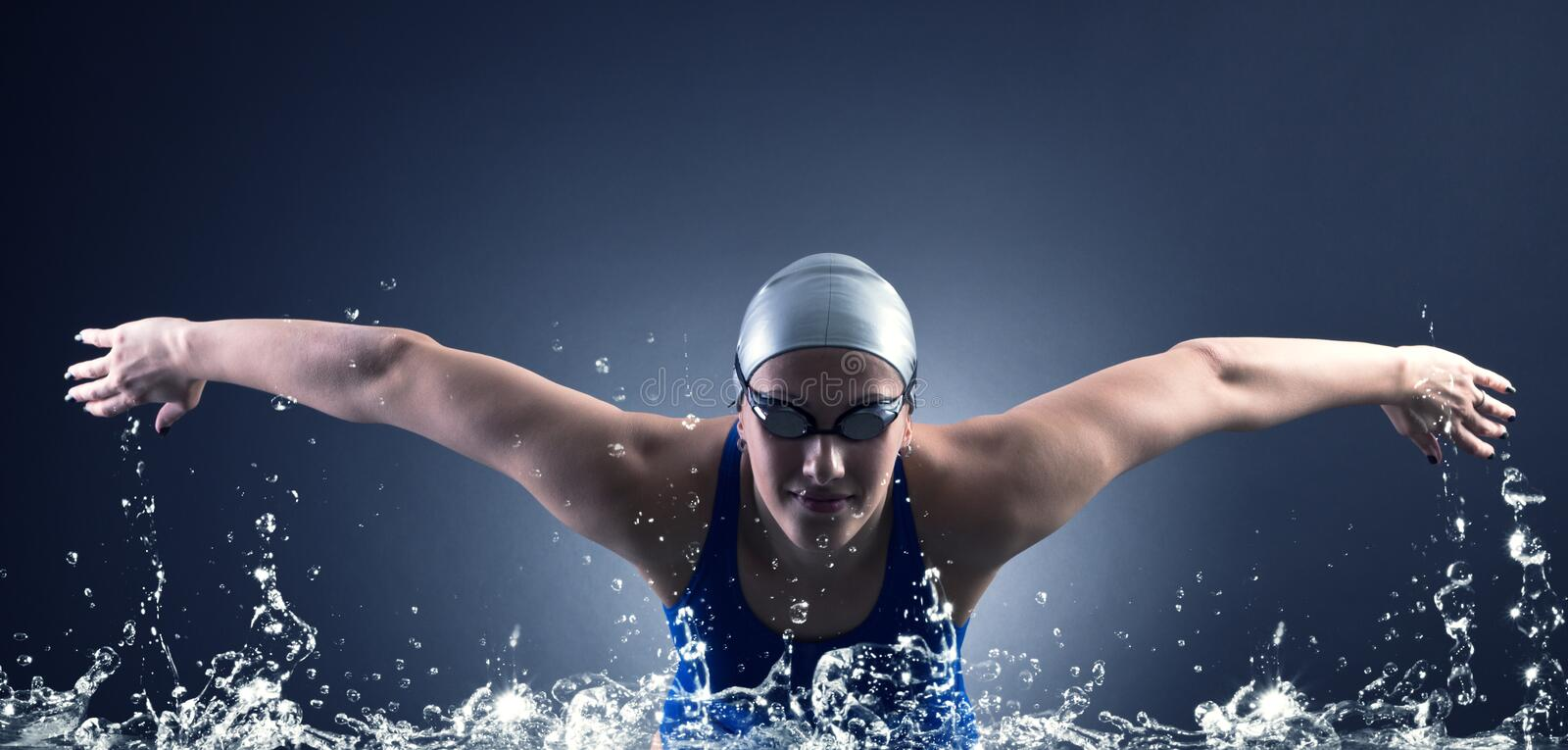 Swimmer swims. Swimmer swims style bracelet on a dark background stock images