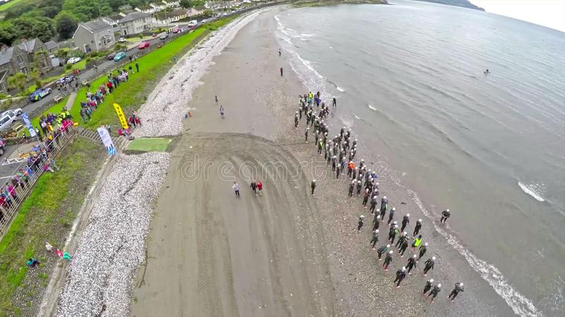 Swimmers in the Dalriada Festival Triathlon in Glenarm Co. Antrim Northern Ireland stock image