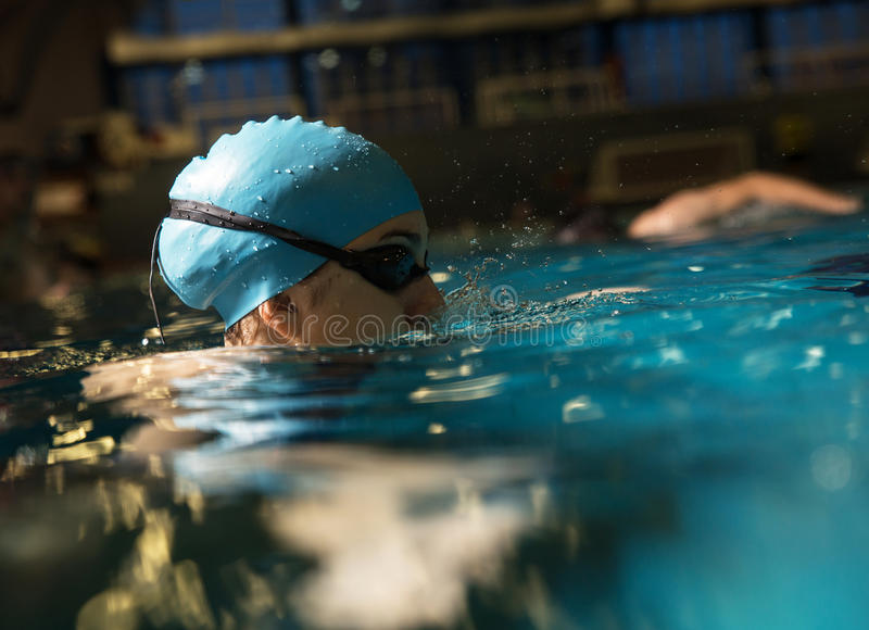 Swimmers stock image image of activity length pursuit 55782265 for Swimming pool certification course