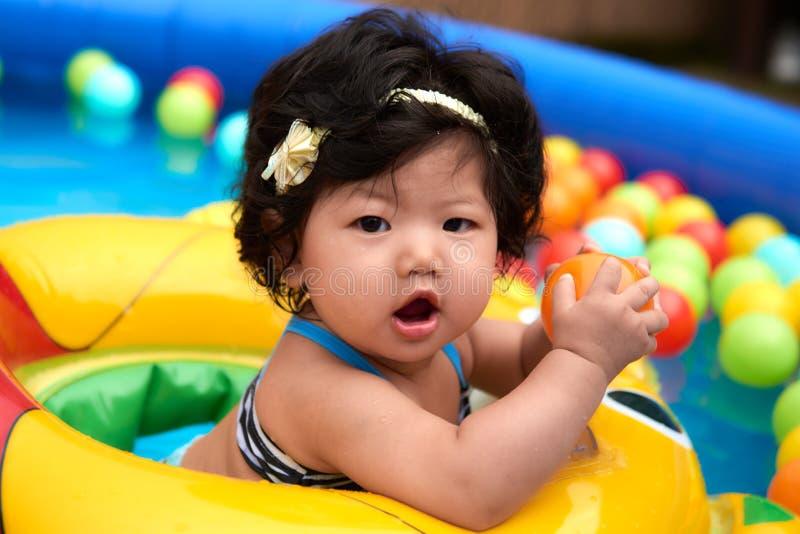 Swimming Baby Girl stock photography