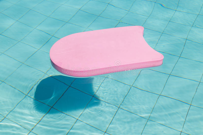 Swimming board , pink foam use for swimming stock photography