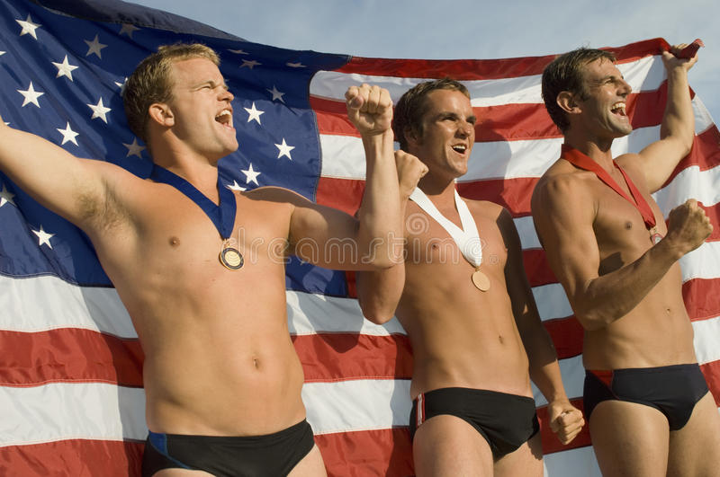 Download Swimming Champions Cheering With Clenched Fists Stock Photo - Image: 29647440