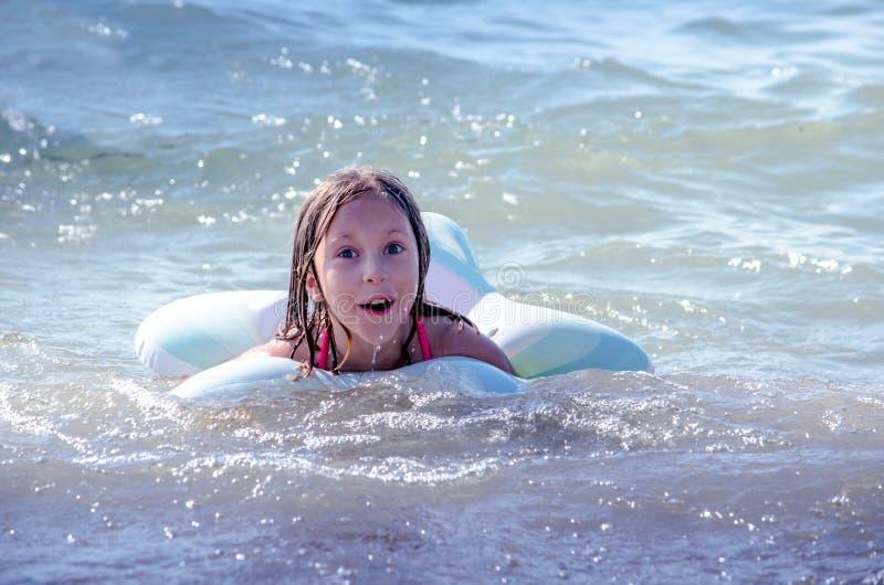 Swimming child on lake Michigan stock photography