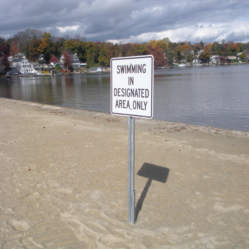 Swimming in Designated Area Only, Lake Hopatcong, New Jersey, USA. A sign on the beach at Lake Hopatcong, New Jersey, tells visitors where to swim royalty free stock photo