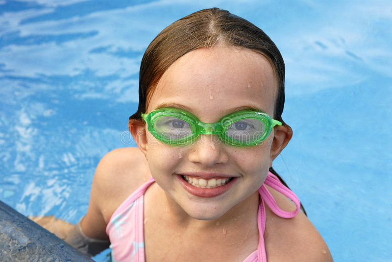 Swimming Girl. This is a picture of my daughter having summer fun in the pool stock image