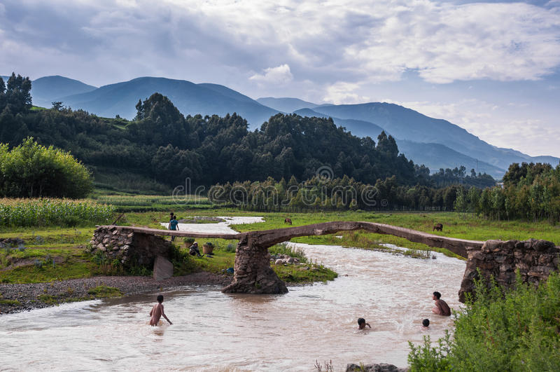 The swimming herding boys. Some herding boys are swimming under the bridge. This scene appeared at Liangshan yi autonomous prefecture, sichuan province of china royalty free stock photos