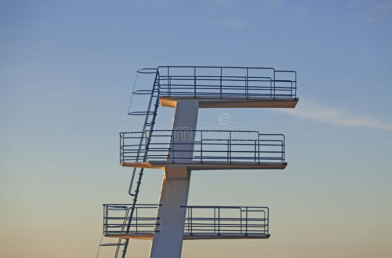Swimming jumping tower in sunset royalty free stock photos
