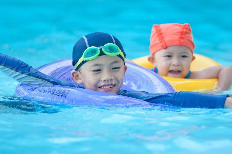 Swimming kid stock photos