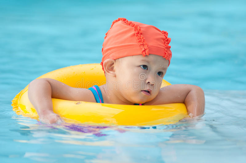 Swimming kid. Cute small asian kid with swim suit stock photography