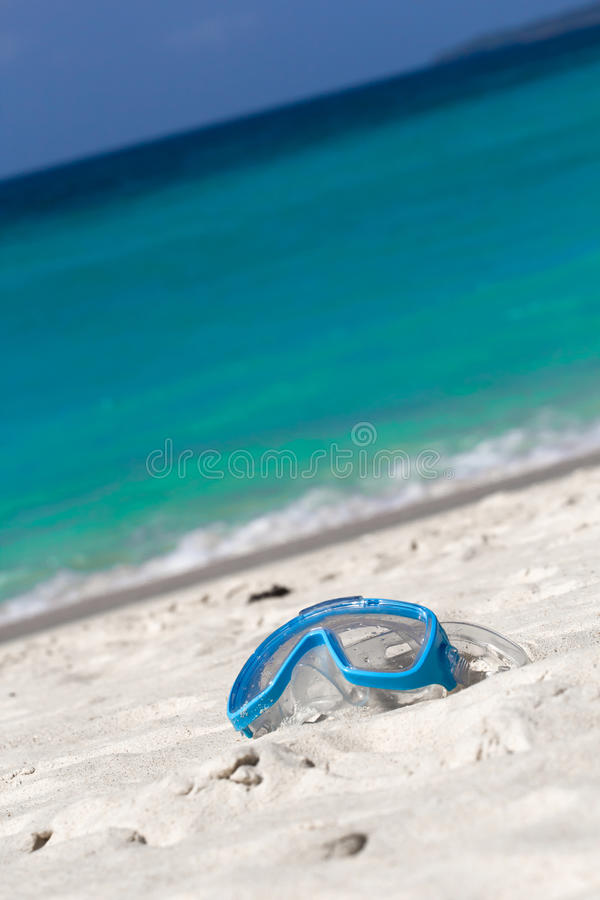 Swimming mask on white sand on tropical beach royalty free stock photos