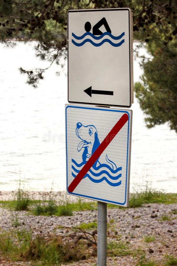 Swimming Permitted sign. No dog allowed sign on sea beach. No dog sign and pets. Forbidden symbol allowed sign prohibited dogs. Signs are allowed for swimming royalty free stock image