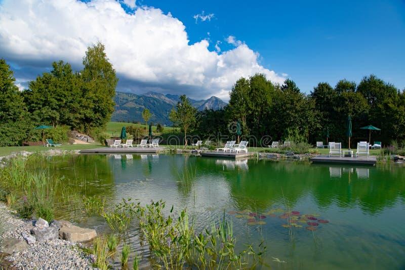 Bathing lake of Hotel and Resort Sonnenalp, Allgau, Bavaria, Germany royalty free stock photo