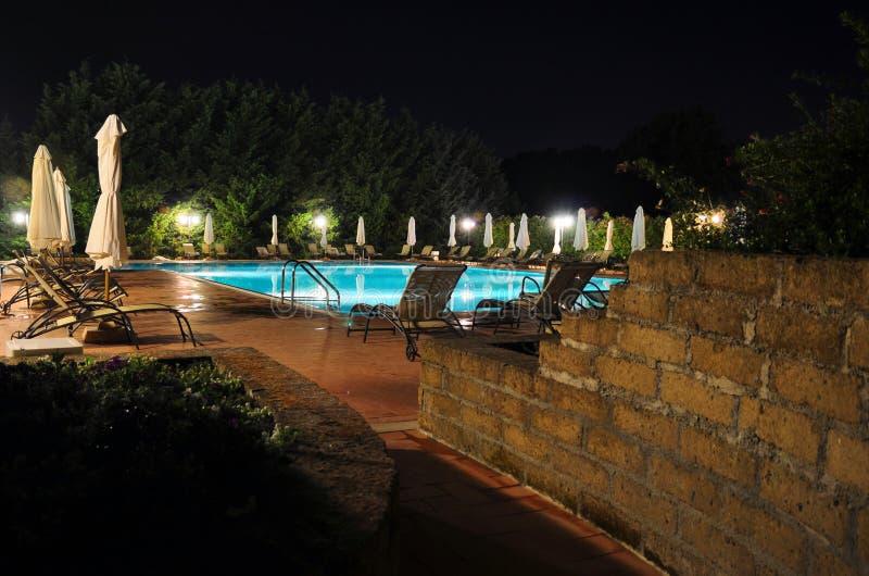 Download Swimming pool stock photo. Image of nightall, umbrellas - 20785528