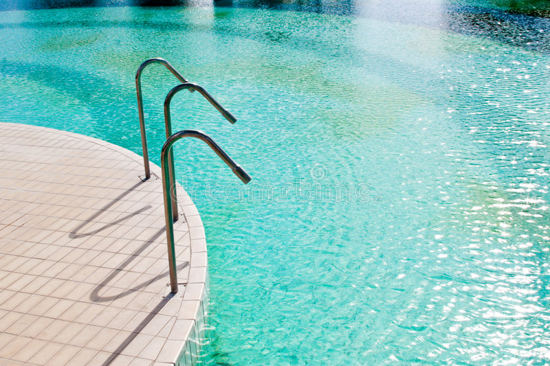 Swimming pool. A particular of a swimming pool stock photos