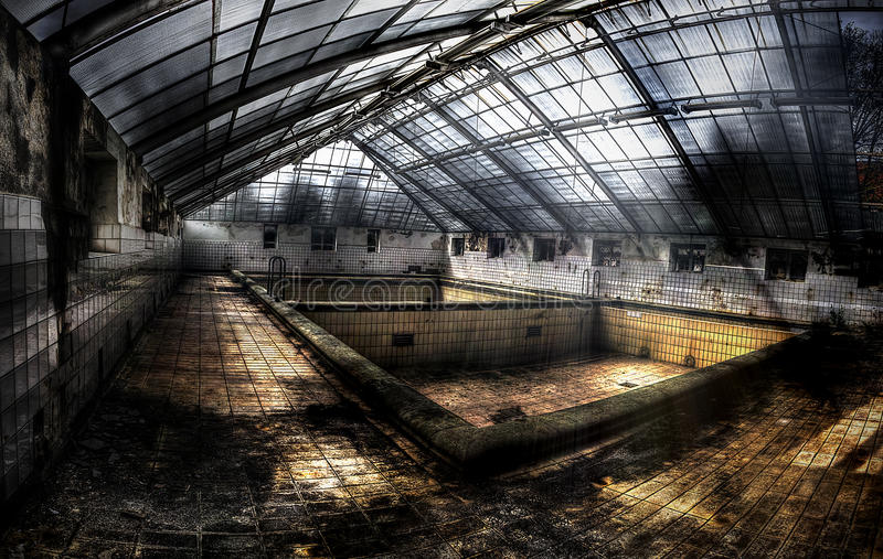 Swimming pool in an abandoned complex. Canopied swimming pool in an abandoned complex, hdr processing stock image